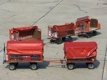 Cargo trolleys. On an airfield royalty free stock photography