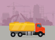Cargo Truck with Tank for Transporting Liquids. On building area. Flat design cement truck icon. Oil and gas industry concept. Trucking vector banner. For cargo Royalty Free Stock Photography