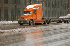 Cargo truck on the urban highway with wall with windows on a background. Truck on the road. Royalty Free Stock Photos