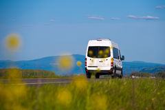 Cargo van inscribed in the natural landscape Royalty Free Stock Photos