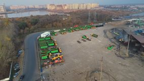 Cargo vehicles stand in a row on a parking lot near the factory warehouse. freight transportation stock video footage