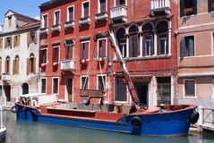 Cargo on venice channel royalty free stock images