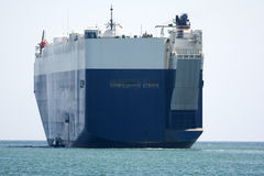 Cargo vessel. Isolated ro-ro ship departing from harbour Stock Photography
