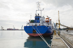 Cargo vessel. At port on a cloudy day Royalty Free Stock Image