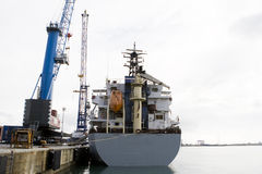 Cargo vessel. Loading operation of a cargo vessel in the port Royalty Free Stock Photo