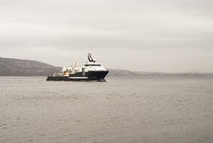 Cargo vessel is coming to port Stock Image