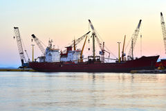 Cargo vessel at the dock Stock Photo