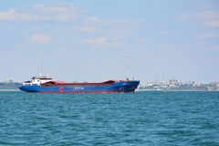 Cargo vessel Elbetor. Leaving Poole Harbour Dorset via the Swash Channel in Bournemouth Bay royalty free stock images