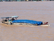 Cargo vessel on Mekong River Stock Photo