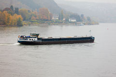 Cargo vessel navigating river Rhine Germany Stock Image