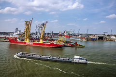 Cargo vessel in sea port Rotterdam, Netherlands. Royalty Free Stock Photo