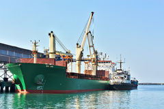 Cargo vessel at the seaport terminal Royalty Free Stock Image