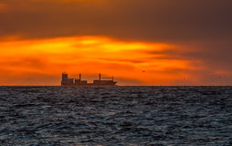 Cargo Vessel In Sunset Royalty Free Stock Photography