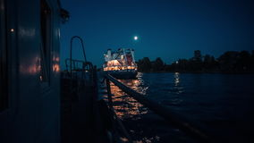 Cargo Vessels Sailing On A River. Cargo vessels sailing on a Neva river at night time stock video footage