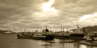 Cargo vessels for scrap. View of old, rusty, cargo vessels for scrap under a dramatic sky Stock Photography