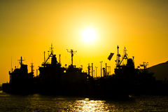 Cargo vessels at the sunset Royalty Free Stock Images