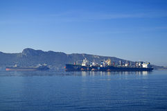 Cargo vessels. View of big cargo vessels side by side at anchorage Royalty Free Stock Image