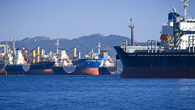 Cargo vessels. View of big cargo vessels side by side at anchorage royalty free stock photography