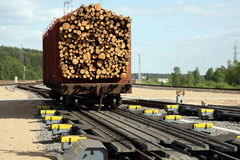 Cargo wagon sorting process. Railway cargo wagon is entering an automated brake in an automated sorting process Stock Photos