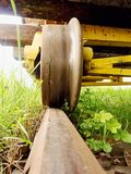 Cargo wagon wheel stay on rusty railway. Old railway wagon wait in depot. Fresh green gras Stock Photo