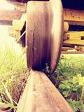 Cargo wagon wheel stay on rusty railway. Old railway wagon wait in depot. Fresh green gras Stock Photos