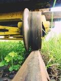 Cargo wagon wheel stay on rusty railway. Old railway wagon wait in depot. Fresh green gras Royalty Free Stock Images