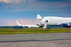 Cargo wide-body aircraft. Is the nose hatch open royalty free stock image