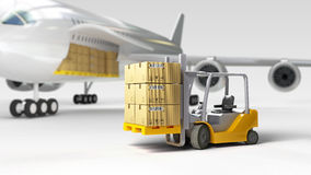 Cargo wide-body plane and aircraft passenger loader near terminal Royalty Free Stock Image