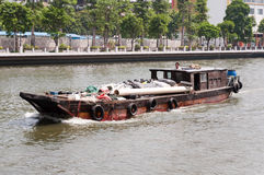 Cargo wood boat in the river Stock Images