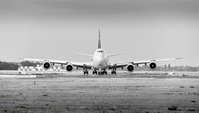 Cargolux airline Boeing 747 airplane with 4 engines on ground monochrome stock photos
