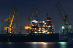Cargoship in the night Stock Images