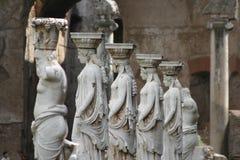 Cariátides y sátiros Imagen de archivo