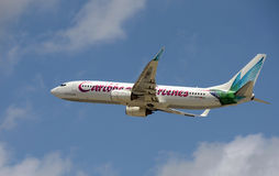 Caribbean Airlines passenger jet takes off into blue sky Royalty Free Stock Photo