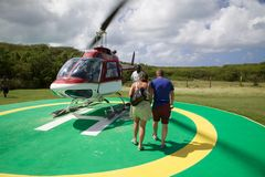 Caribbean, Antigua, Couple Approaching Helicopter Stock Photos