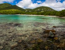 Caribbean Bay, Virgin Islands, St. John, Clear Water. A clear water bay on St. John in the U.S. Virgin Islands.  View of resort in distance.  Within Virgin Royalty Free Stock Photo