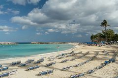 Caribbean Beach. Beautiful white caribbean beach with canvas chairs Royalty Free Stock Image