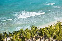 Caribbean Beach From Above, Antigua. A beautiful caribbean beach with lots of palm trees and tall waves seen from a high observation point. Galley Bay, Antigua royalty free stock image