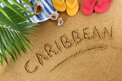 Caribbean beach. Background with towel, seashells, palm leaves and flip flops Stock Photo