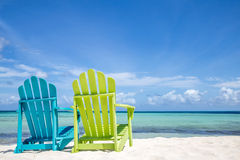 Caribbean Beach Chairs. A beach scene with a set of colorful wooden beach chairs Stock Images