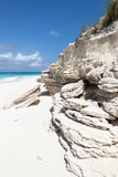 Caribbean Beach Erosion. The rocky beach landscape under erosion on uninhabited island Half Moon Cay Bahamas stock images