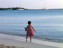 Caribbean Beach Girl. Child walking on a Caribbean beach at sunset Royalty Free Stock Image