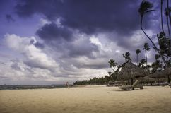 Caribbean beach with golden sand with storm clouds royalty free stock images