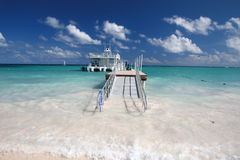 Caribbean beach, jetty and ferry boat Stock Photography