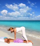 Caribbean beach massage shiatsu waist therapy Stock Photos