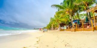 Caribbean beach on a overcast day. Thunderstorm approaching the. Beach stock photo