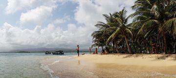 Caribbean Beach with Palm Trees on the San Blas Islands between Panama and Colombia.  Stock Photography