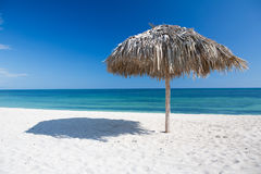Caribbean beach with parasol in Cuba Stock Photos