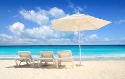 Caribbean beach parasol white umbrella hammocks. Caribbean beach parasol white umbrella and hammocks turquoise sea Royalty Free Stock Photos