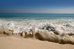 Caribbean beach shore with rocky   coastline Stock Images