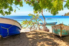 Caribbean Beach in Small Tropical Fishing Village. Clear Waters. Fishing Boats. Summer Day. Blue Skies. Dominican Republic.  royalty free stock image